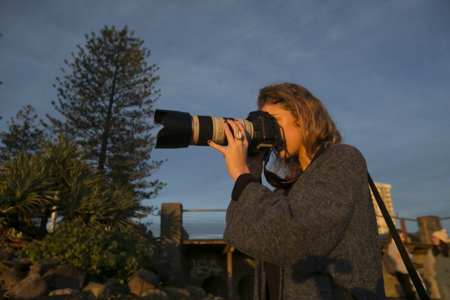 A women holding a camera during The Photo Coach Outdoor Workshop